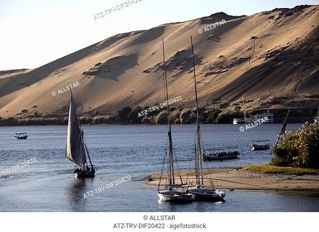 SAILING FELUCCAS & SAND DUNES; RIVER NILE, ASWAN, EGYPT; 11/01/2013