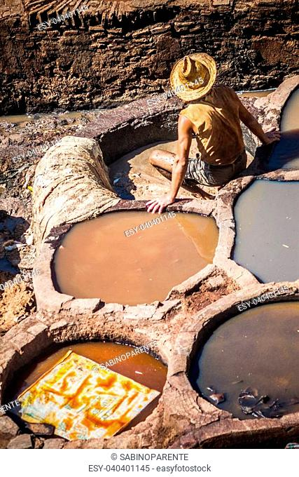 Tanners working leather in the old tannery of Fes, Morocco