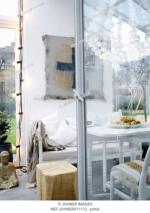 A glass-enclosed veranda, Sweden