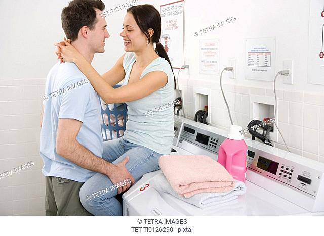 Couple hugging in laundry room