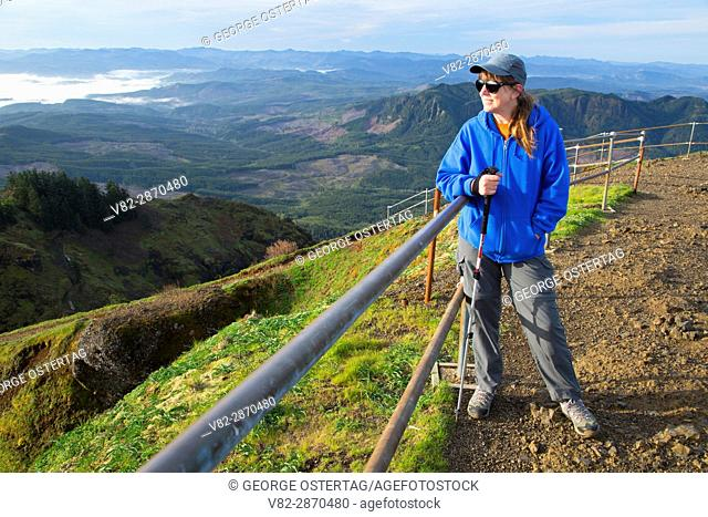 Hiker on summit viewpoint, Saddle Mountain State Park, Oregon