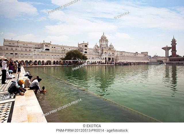 Sikh pilgrims at Nectar Pond in Golden Temple, Amritsar, Punjab, India