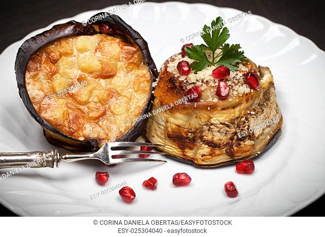 Eggplant zuccotto made with scamorza cheese, decorated with parsley and pomegranate. Typical dish of Italian cuisine
