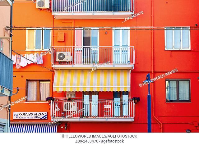 Brightly painted apartment block, Chioggia, Venetian Lagoon, Veneto, Italy, Europe