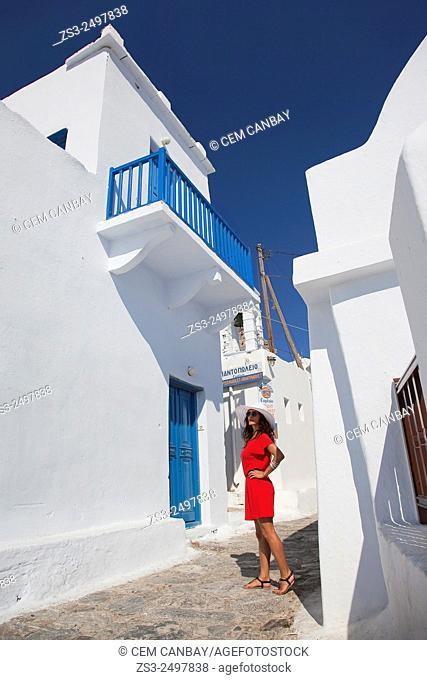 Woman having a walk in town center, Amorgos, Cyclades Islands, Greek Islands, Greece, Europe