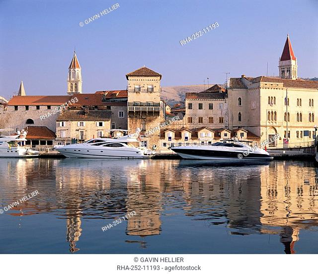 Boats moored in front of the Old Town, Trogir, UNESCO World Heritage Site, Dalmatia, Croatia, Europe