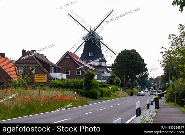 Harlesiel / Carolinensiel, Germany June 2020: Symbolic images - 2020 entrance from the North Sea resort Carolinensiel with the mill in the background