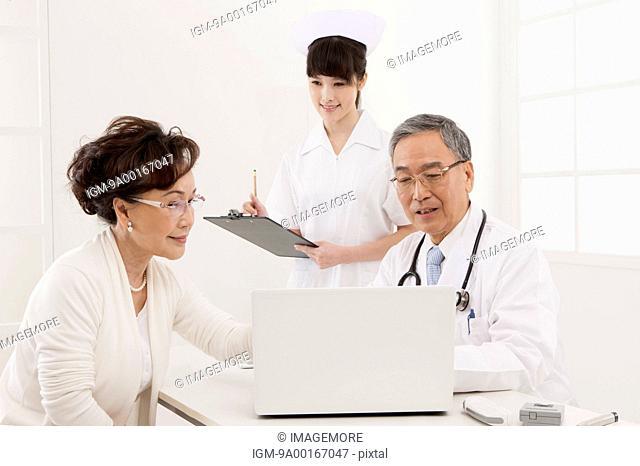 Senior woman making medical exam and looking down