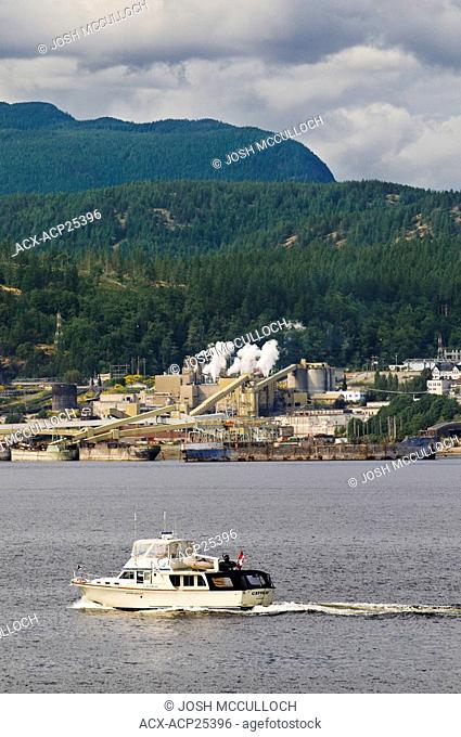 Recreational boating, a popular activity along the Sunshine Coast, including here in Powell River, BC. Powell River's Pulp and Paper Mill shown in the...