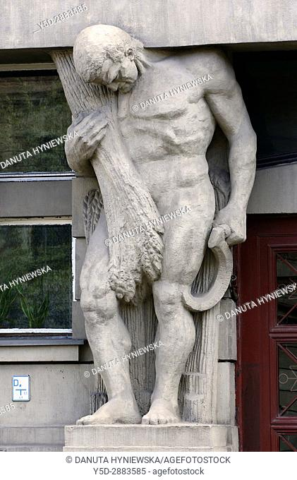 Atlante - one of five full size statues in entrance to tenement house Narutowicza street number 45 built in 1913, Lodz, Poland, Europe