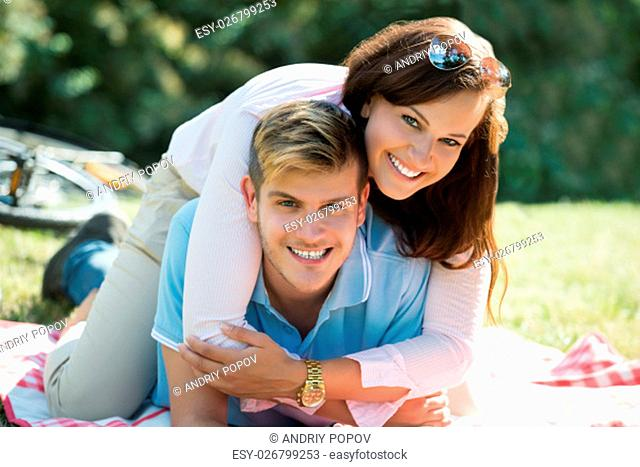Portrait Of Happy Couple Enjoying In The Park