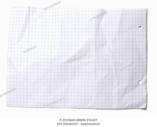 Crumpled squared sheet of paper isolated on white