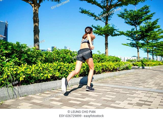 Woman running at outdoor park