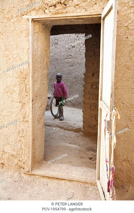 Boy standing in Courtyard at Djenne, Mali