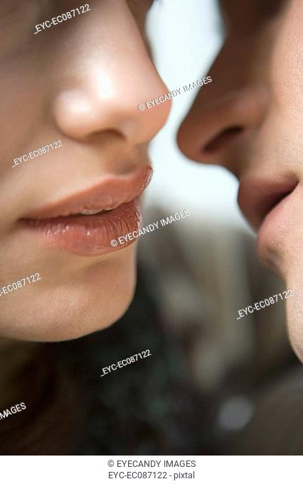 Close-up of couple about to kiss