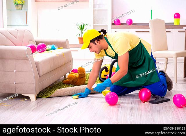 The young male contractor doing housework after party