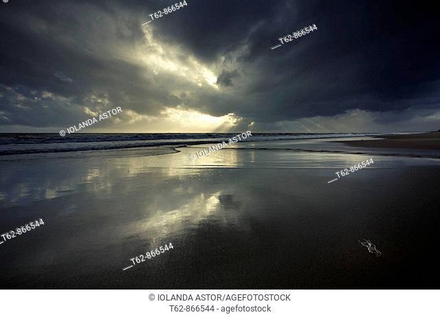 Sun putting in winter Beach of the Costa Dorada, Catalonia, Spain  Mediterranea Sea