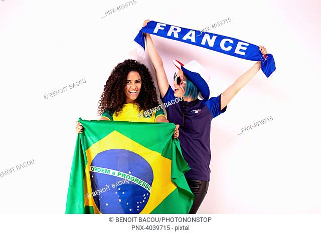 Portrait of two young fans of the Brazilian team and the French fraternising team