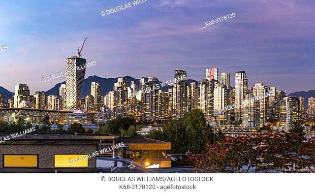 Skyline at twilight, with Vancouver House tower on left, Vancouver, BC, Canada