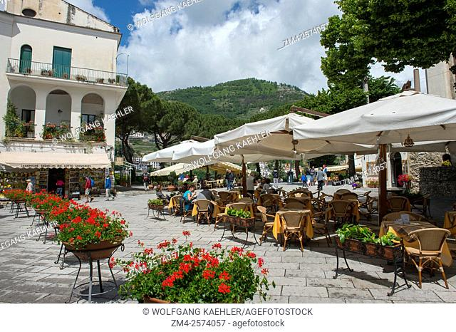 The main square with sidewalk restaurants in the center of Ravello, a town above the Amalfi Coast, Italy