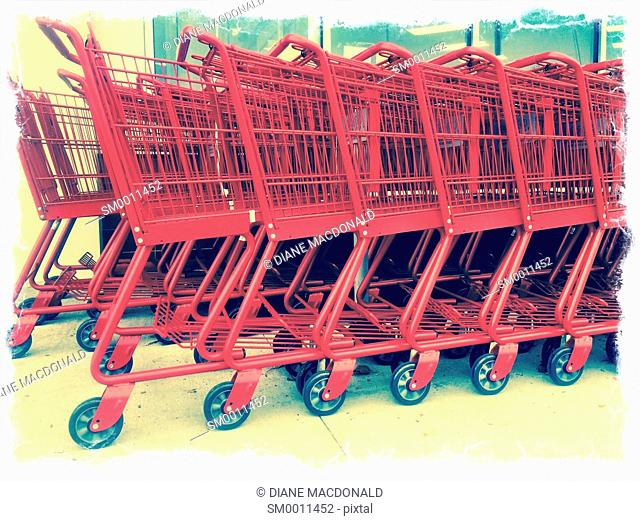 A row of red shopping carts