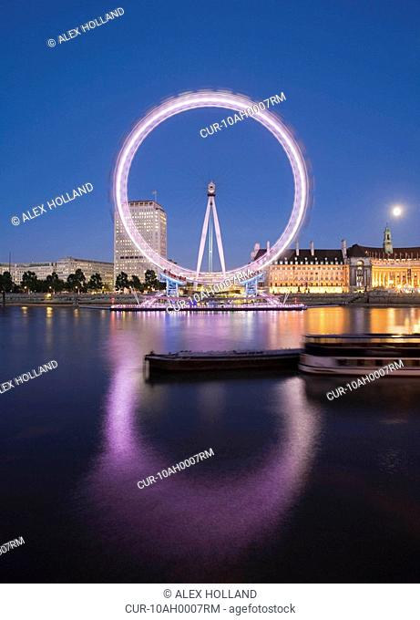 A long exposure image of the London Eye situated by the River Thames on the South Bank