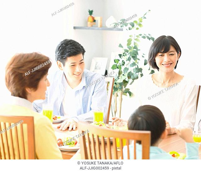 Japanese family together in the kitchen