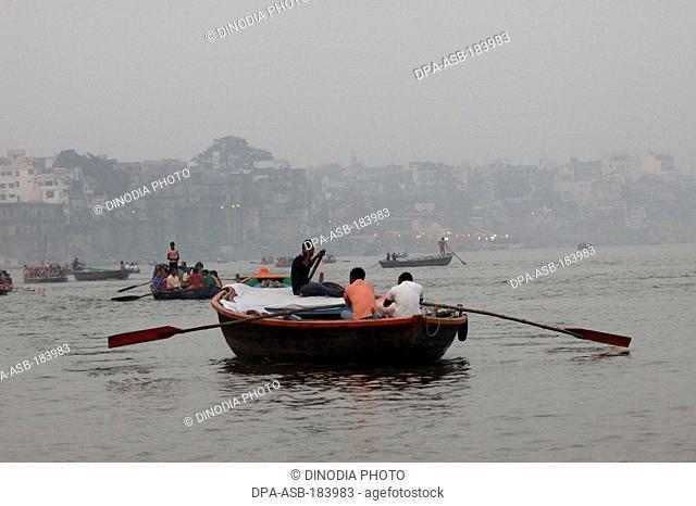 boatman in Ganga River at Varanasi Uttar Pradesh India