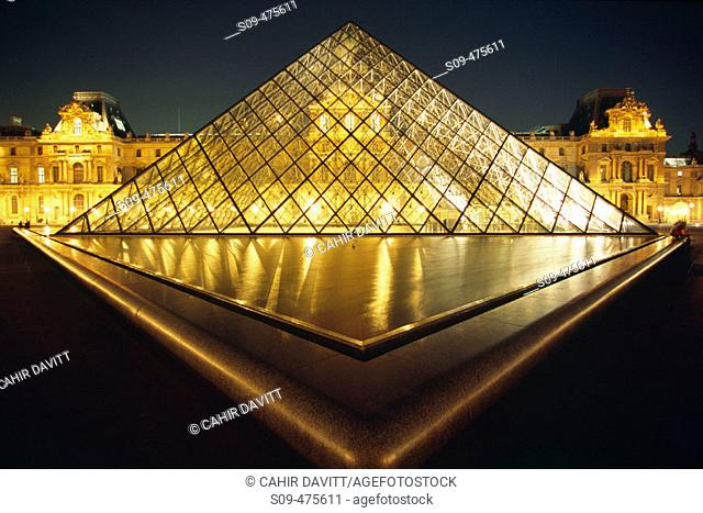The Pyramid of the Le Grand Louvre Art Gallery and Cour Napolean by night in Paris, Ile de France, France