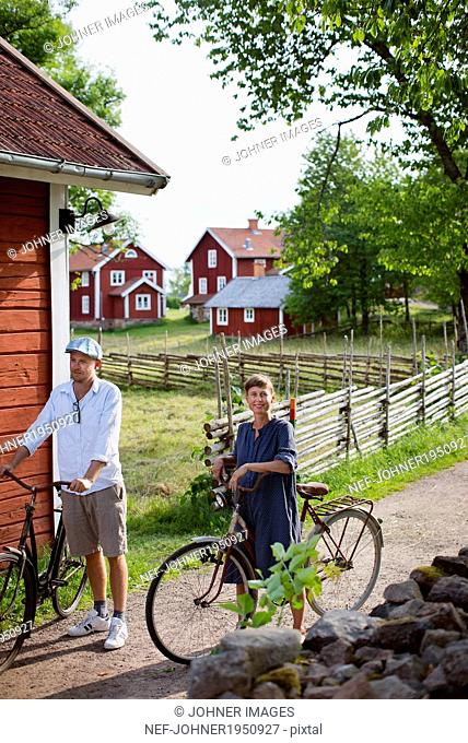 Mature couple cycling, Smaland, Sweden