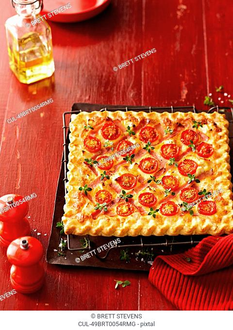 Square pizza with tomatoes and herbs