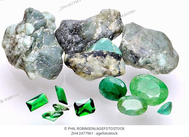 Emerald - rough mineral and cut gemstones