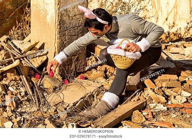 Easter bunny hiding eggs among the rubble of an abandoned house