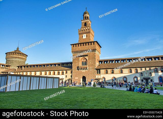 MILAN, ITALY - SEPTEMBER 2015: Tourists visit Sforza Castle and Park in summer season