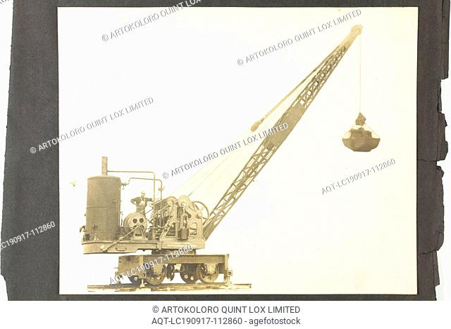 Photograph - A.T. Harman & Sons, Side View of a Rail-Mounted Excavator, circa 1923, A black and white photograph attached to an album page