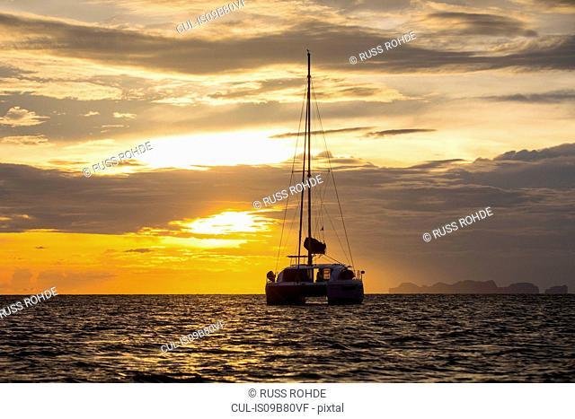 Yacht sailing on sea at sunset, Ban Koh Lanta, Krabi, Thailand, Asia