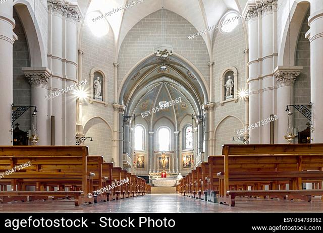 Interior view of a church. Beautiful view on nave from altar inside cathedral church. Interior of catholic basilica with sun rays from windows