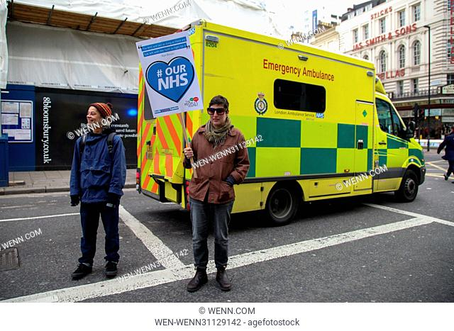 Thousands of protesters take part in The People's Assembly's NHS national demonstration marching in London against the government's programme of cuts in NHS