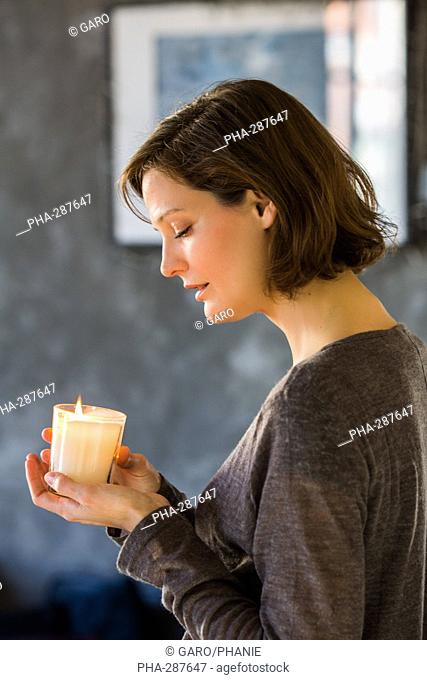 Woman holding scented candle