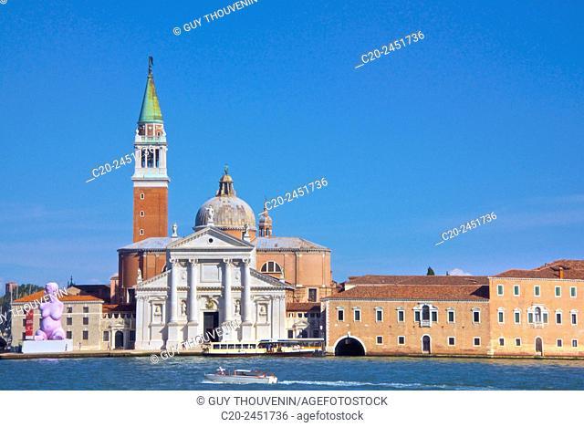 Statue of pregnant woman Alison Lapper by Marc Quin, 2012, La Salute Church, and tourist boat on canal Grande, Dorsoduro, Venice, Venetia, Italy