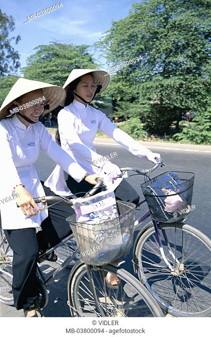 Vietnam, Mekong delta, Can Tho, Schoolgirls, straw hats, driving wheels Southeast Asia, natives, girls, students, Women, young, Vietnamese, two, cyclists