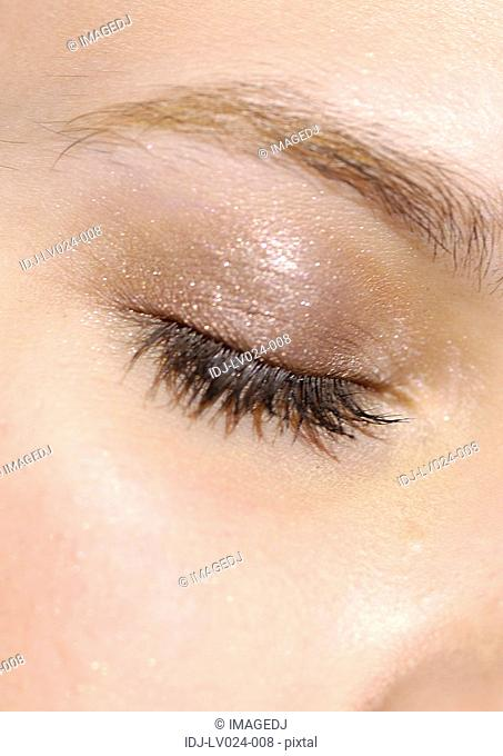 Close-up of a closed eye of a woman