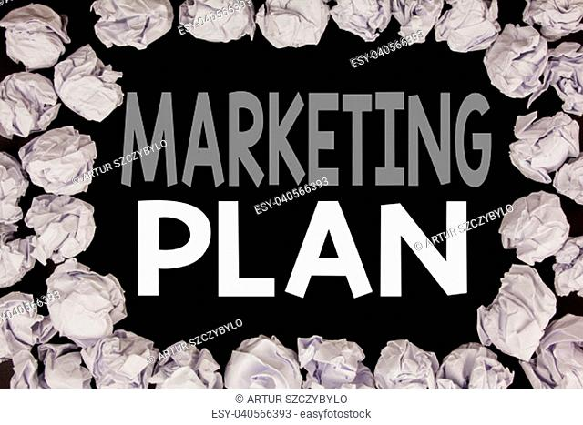 Word, writing Marketing Plan. Business concept for Planning Successful Strategy written on black background with copy space on background with folded paper...