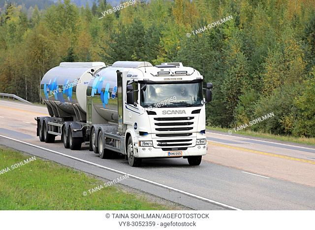 Scania R450 milk tank truck transports Valio milk on highway through autumn scenery in Jamsa, Finland - September 21, 2017