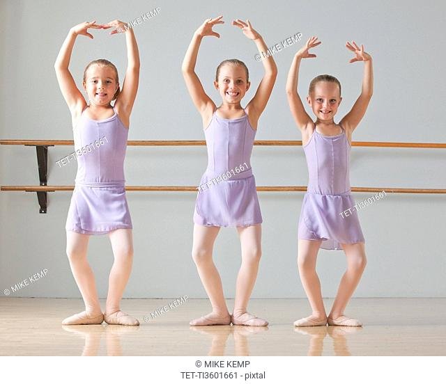 Portrait of three ballet dancers 6-7 in dance studio