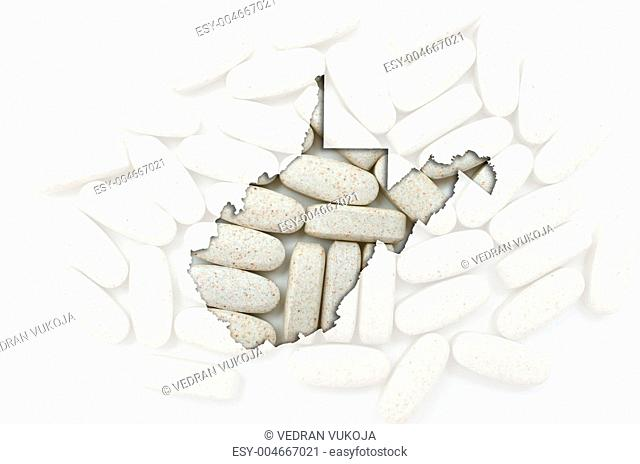 Outline map of west virginia with transparent pills in the backg