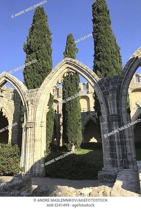 """Bellapais Monastery inner court, Kyrenia, North Cyprus. Bellapais Abbey, or """"""""the Abbey of Beautiful Peace is the ruin of a monastery built by Canons Regular in..."""