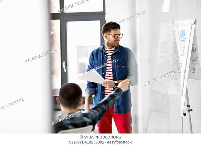 creative man showing user interface at office