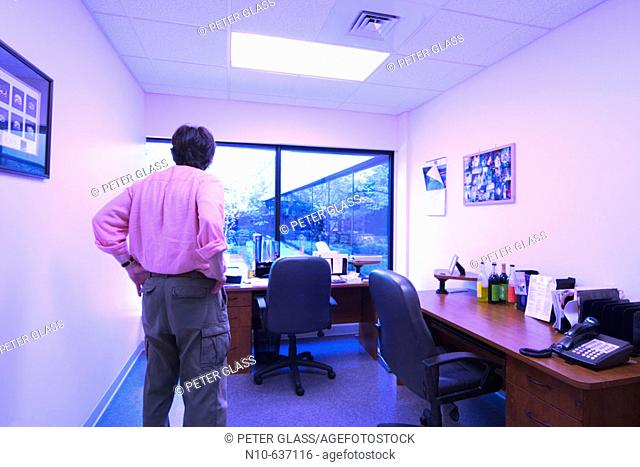 Man standing in an empty business office