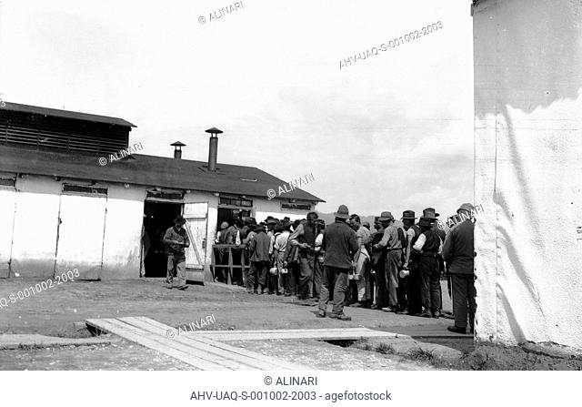 Internment Camp Katzenau, a suburb of Linz, Austria: prisoners in line for the meal, shot 1915-1918 by Internat. Photogr. Ausstellung Dresden